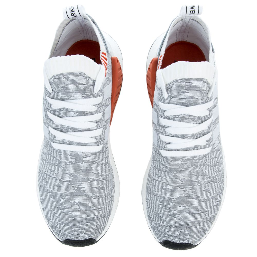 768a657e49bc6 ... The NMD R2 PK in White and Coral Black FTWWHT FTWWHT CBLACK ...
